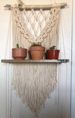 macrame wall hanging with shelf and plants