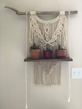 macrame wall hanging with shelf