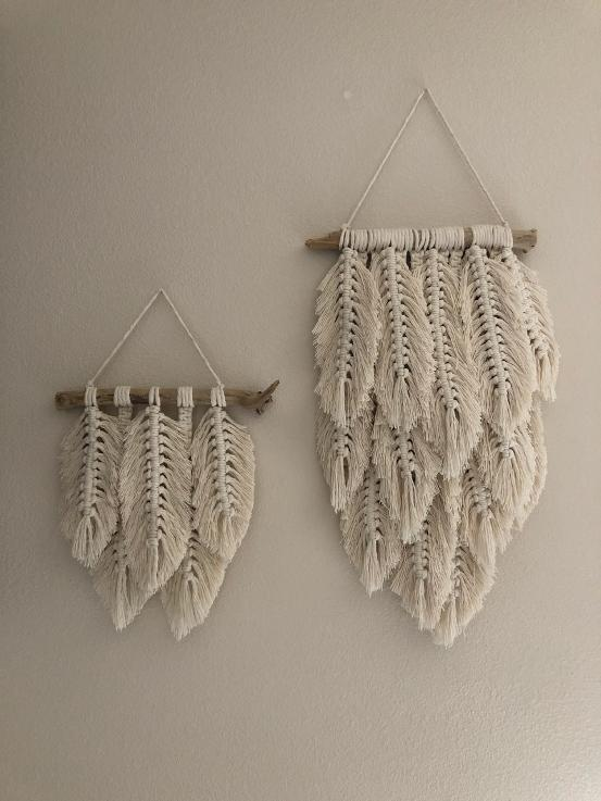 multiple macrame feathers driftwood