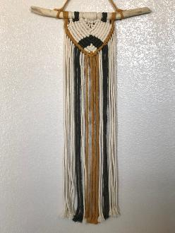 Macrame wall hanging mustard, black, and white on driftwood