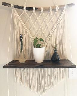 v macrame wall hanging with shelf plants
